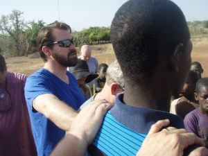 Pastor Dan praying over one of the new believers!